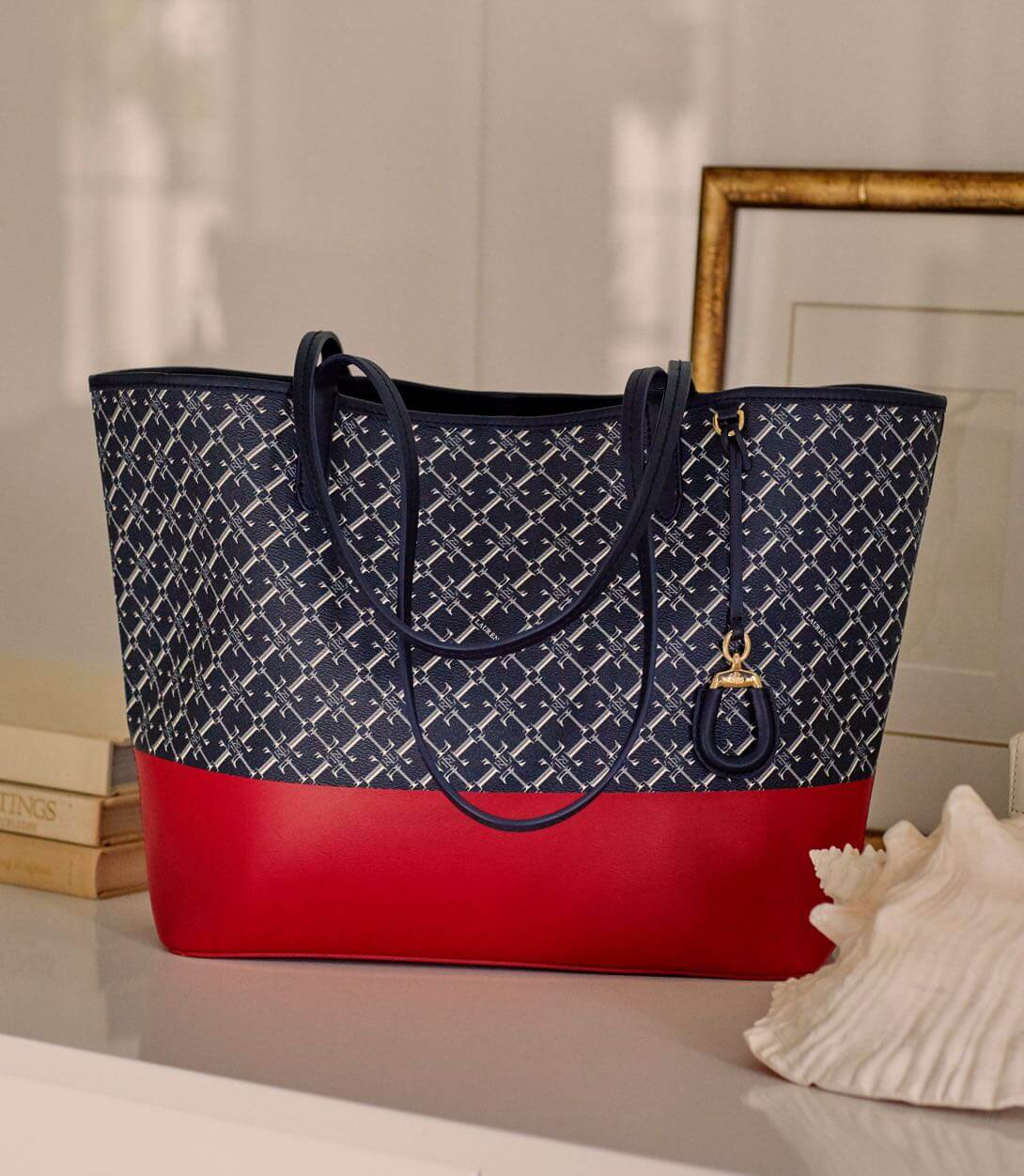 Navy print tote with red accents.
