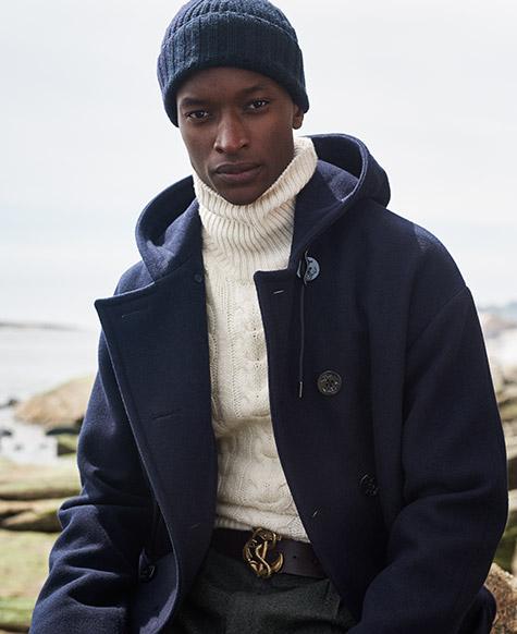 Man in hooded navy peacoat