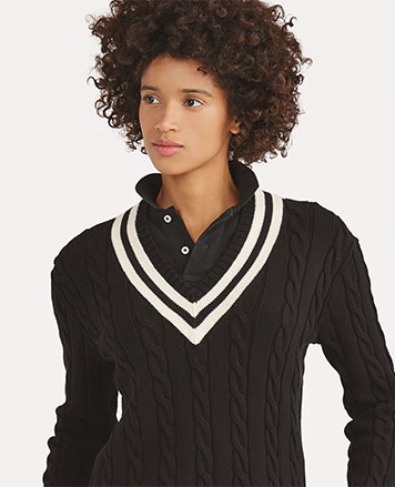 Woman in black cable cricket sweater