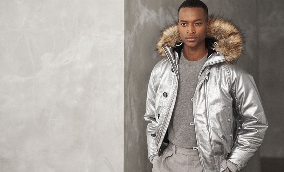 Man in silver jacket with faux-fur-trim hood