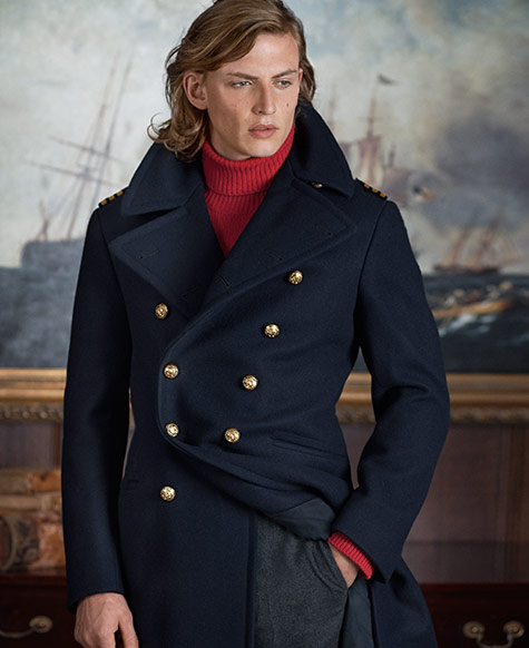 Man in double-breasted peacoat over red turtleneck