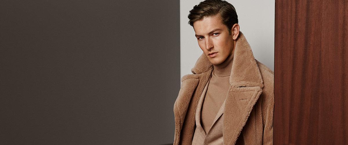 Man in faux-fur tan coat