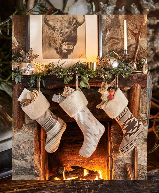 Stockings of various patterns hanging on fireplace