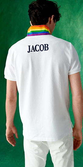 Jacob Bixenman in white Polo shirt with rainbow-stripe collar