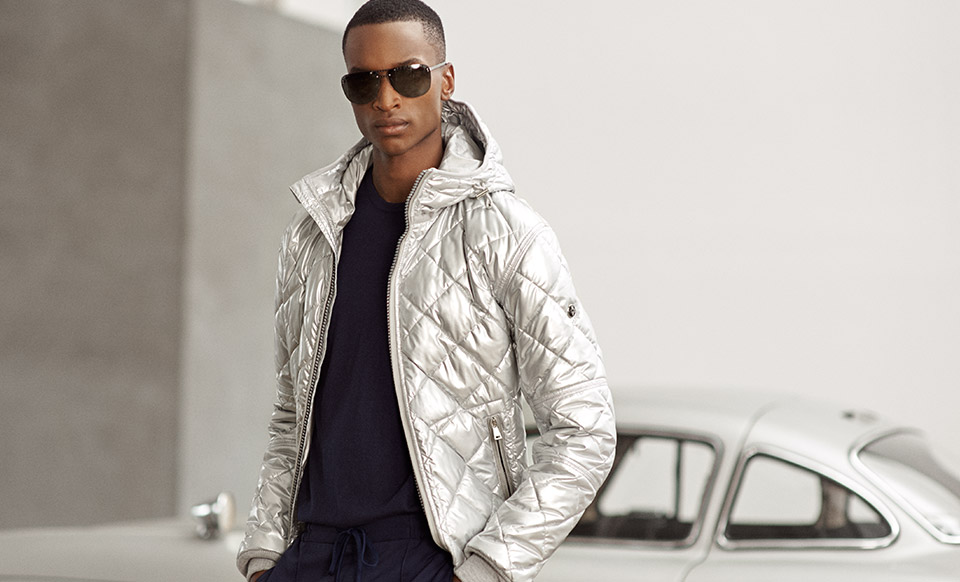 Man in metallic quilted jacket & sunglasses